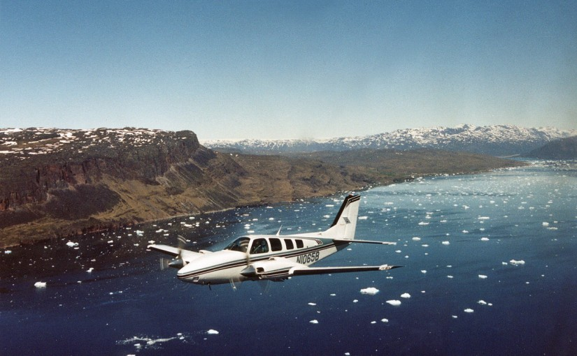 John Hogg in his Beach Baron flying up the fjord in Greenland prior to landing at Narsarsuaq.